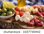 assorted deli meats and a plate ... | Shutterstock . vector #1037730442