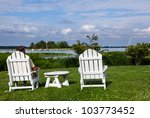 patio chairs by side of the...   Shutterstock . vector #103773452