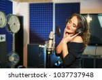 woman singing in a recording... | Shutterstock . vector #1037737948