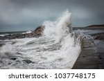waves and storm surge crash...   Shutterstock . vector #1037748175