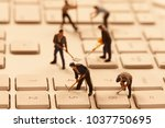 miniature people working with pc | Shutterstock . vector #1037750695