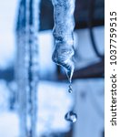 melting icicle with drops of... | Shutterstock . vector #1037759515