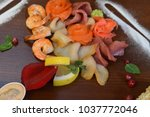 mixed seafood salad in dish the ... | Shutterstock . vector #1037772046
