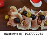 salad of cold cuts with olive ... | Shutterstock . vector #1037772052