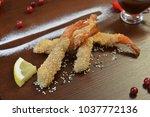 shrimp fried in breadcrumbs.... | Shutterstock . vector #1037772136
