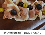 salad of cold cuts with olive ... | Shutterstock . vector #1037772142