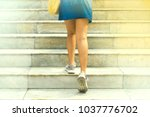woman walking on the ladder.... | Shutterstock . vector #1037776702
