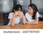 girl trying to comfort and... | Shutterstock . vector #1037787055