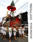 Small photo of Kyoto, Japan - July 17 2017 - Gion Matsuri, Huge float parade and festival in traditional way. Beautiful costume. Men pulling floats with a rope.