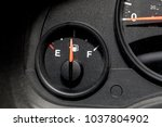 low fuel guage shown in a car... | Shutterstock . vector #1037804902