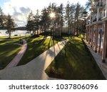 calm sunny morning park near... | Shutterstock . vector #1037806096