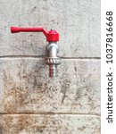 red faucet on cement wall | Shutterstock . vector #1037816668