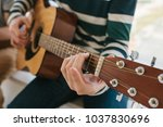 learning to play the guitar.... | Shutterstock . vector #1037830696