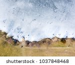 aerial view of frozen lake.... | Shutterstock . vector #1037848468