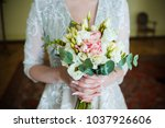 bride holding wedding bouquet... | Shutterstock . vector #1037926606