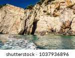 boat heading to an isolated... | Shutterstock . vector #1037936896