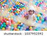 asian little girl play with...   Shutterstock . vector #1037952592
