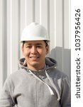 young asian engineer ... | Shutterstock . vector #1037956426