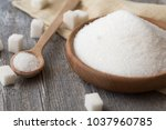 sugar in spoon and plate.  | Shutterstock . vector #1037960785