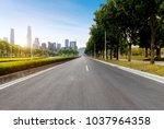 highway and city building in... | Shutterstock . vector #1037964358