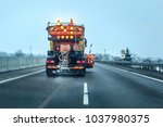 view from the car behind orange ... | Shutterstock . vector #1037980375