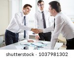 business people shaking hands... | Shutterstock . vector #1037981302
