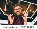 impressionable beard man... | Shutterstock . vector #1037990986