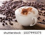 cup of cappuccino coffee on... | Shutterstock . vector #1037995375