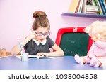 pretty little girl teach the... | Shutterstock . vector #1038004858