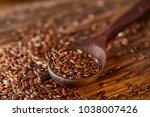 wooden spoon with flax seeds on ... | Shutterstock . vector #1038007426