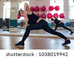 the woman in a gym doing... | Shutterstock . vector #1038019942