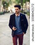 attractive man in the street... | Shutterstock . vector #1038042172