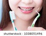 woman wear brace and take... | Shutterstock . vector #1038051496