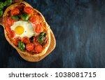 homemade tasty pizza with egg ... | Shutterstock . vector #1038081715