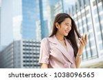 young asian working woman going ... | Shutterstock . vector #1038096565