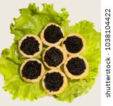 black sturgeon caviar in... | Shutterstock . vector #1038104422