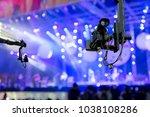 video camera on crane  covering ... | Shutterstock . vector #1038108286