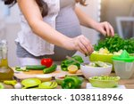 happy pregnant woman cooking at ... | Shutterstock . vector #1038118966