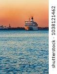 white passenger ship moving... | Shutterstock . vector #1038121462