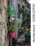 lamp and flowerpot on the... | Shutterstock . vector #1038122932