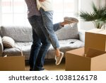 happy couple on moving day... | Shutterstock . vector #1038126178