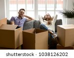 happy couple relaxing on couch... | Shutterstock . vector #1038126202