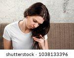young  beautiful girl is... | Shutterstock . vector #1038133396