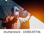 industrial worker at factory... | Shutterstock . vector #1038135736