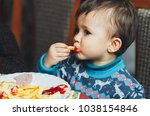 child eating fries with your... | Shutterstock . vector #1038154846