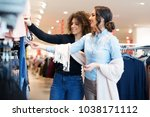 two young girls look at... | Shutterstock . vector #1038171112