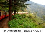 train moving on mountain slopes ... | Shutterstock . vector #1038177376