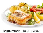 fried fish with potatoes  | Shutterstock . vector #1038177802