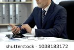 man in business suit checking... | Shutterstock . vector #1038183172
