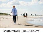 nordic walking   woman training ... | Shutterstock . vector #1038185695